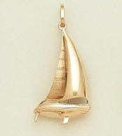 4729cacf6 Extra beamy deck details, our most elegant gold sculptured sailboat  pendant. Sailing jewelry at it's best! Just add a necklace chain.